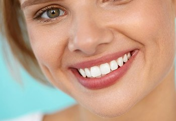 Smiling woman after visiting her Fort Worth cosmetic dentist