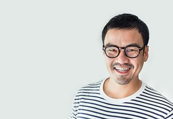person wearing glasses and smiling